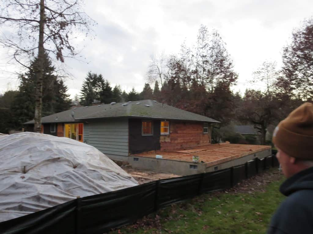 Heres a photo from January when they were just getting started with the framing. We added 2 additions on both sides of the house, about 900 sf total.